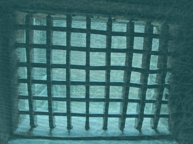 Bars on prison window.