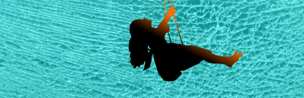 Young girl on swing silhouette