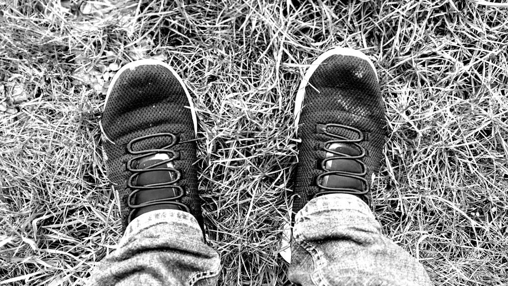 Black and White photo of a pair of trainers.